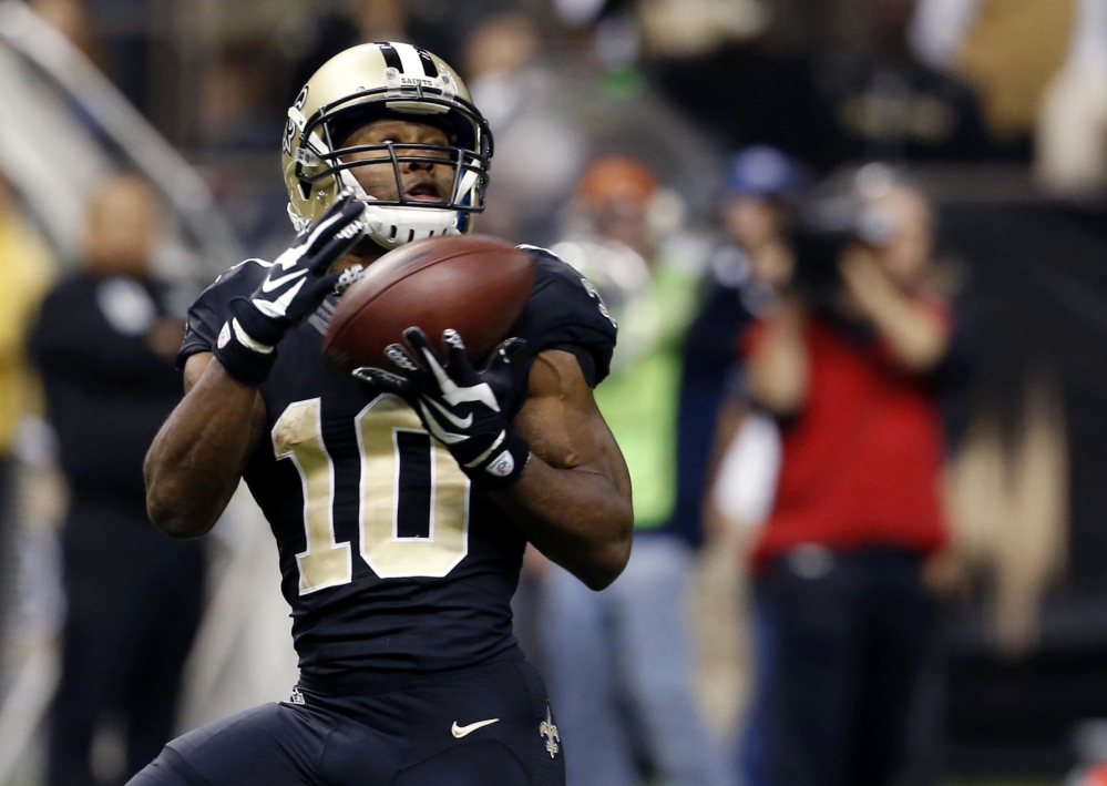 New Orleans Saints wide receiver Brandin Cooks (10) pulls in a touchdown pass during the second half of Dec. 6, 2015 game against the Panthers in New Orleans