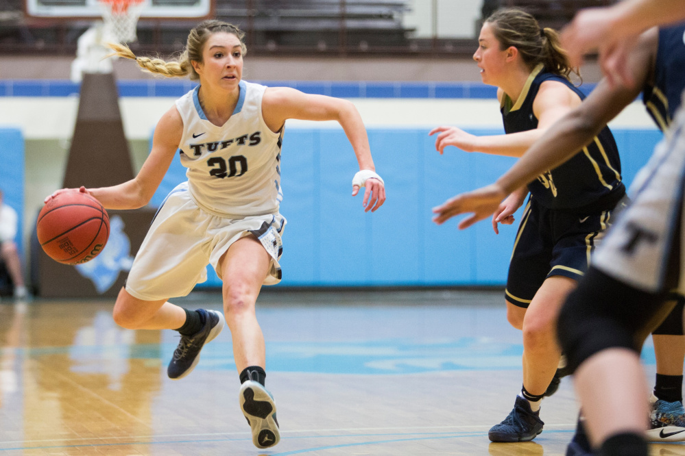 Tufts guard and Cony graduate Josie Lee (20) brings the ball up the court during a game against Trinity College back in February. The Jumbos defeated the Bantams, 74-39.