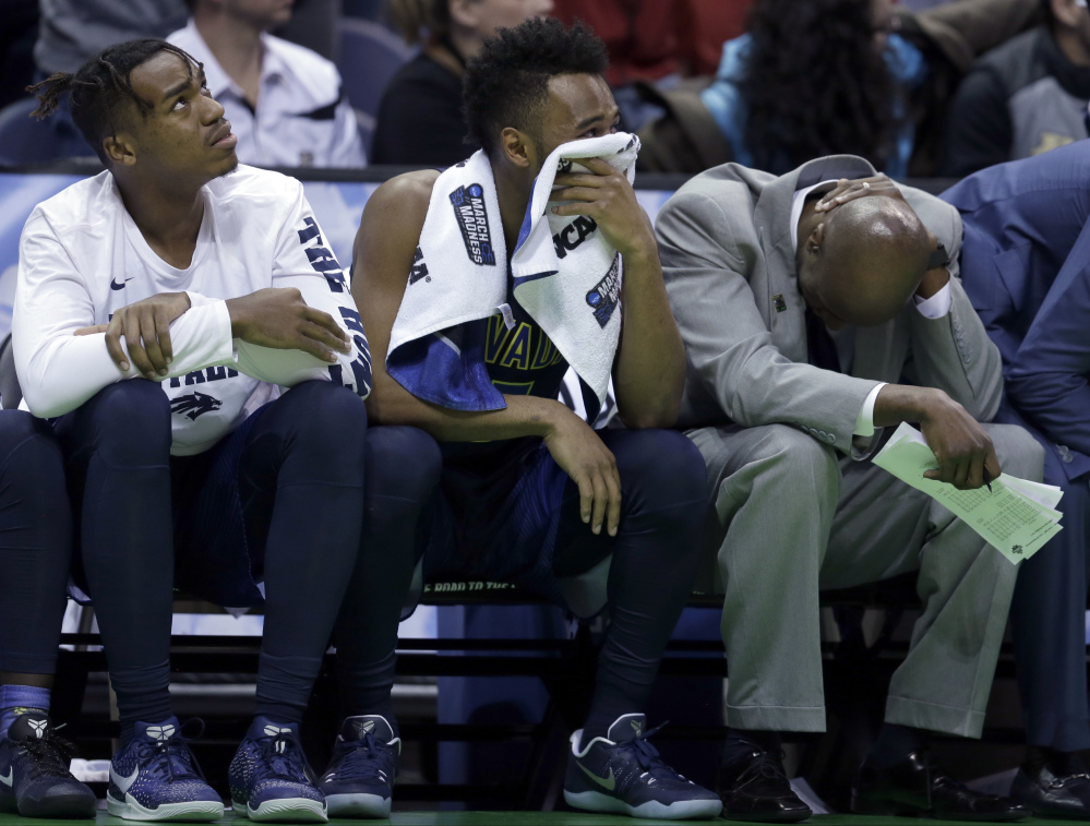 The Nevada bench reacts in the final minutes of a first-round game against Iowa State on Thursday in Milwaukee. Iowa State won 84-73.