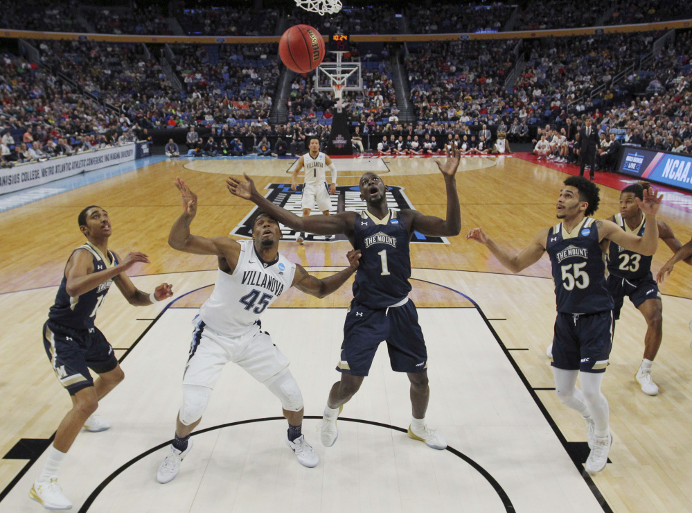 AP photo   Villanova forward Darryl Reynolds (45) and Mount St. Mary's center Mawdo Sallah (1) battle for a rebound during the first half of a first-round game Thursday in the NCAA Tournament in Buffalo, N.Y.