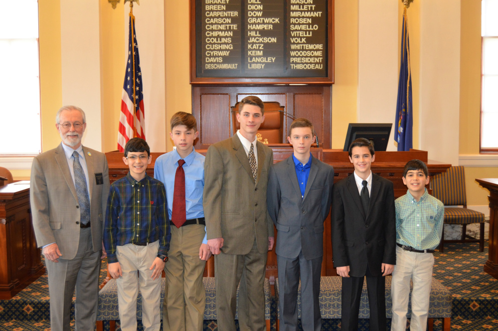 Sen. Rod Whittemore, R-Skowhegan,, left, with the Somerset Homeschool Co-op Robotics Team member seventh grader Jeremy Caruso, seventh grader Ashton Umbrianna, eighth grader Tregg Umbrianna, seventh grader Isaiah Simoneau, seventh grader Caleb Haynes and sixth grader Christopher Caruso. Missing from photo are seventh grader Carter Houle and fourth grader Sawyer Merrill.