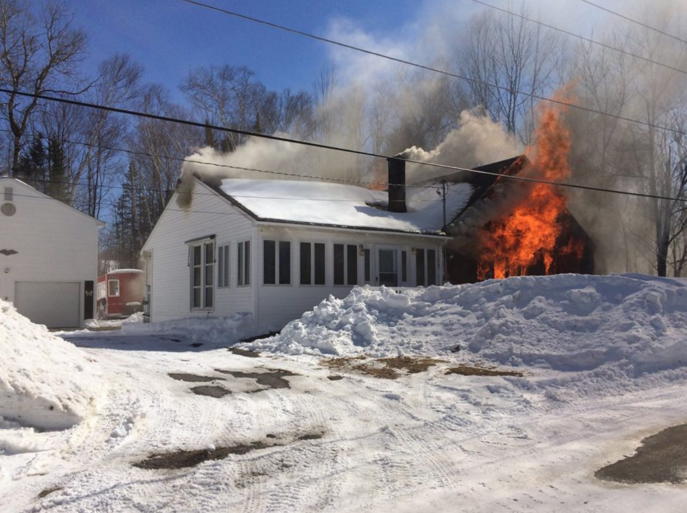 A second home at 30 Mill Road in Jackman is engulfed by fire Sunday afternoon in a photo provided by the Jackman-Moose River Fire Department.