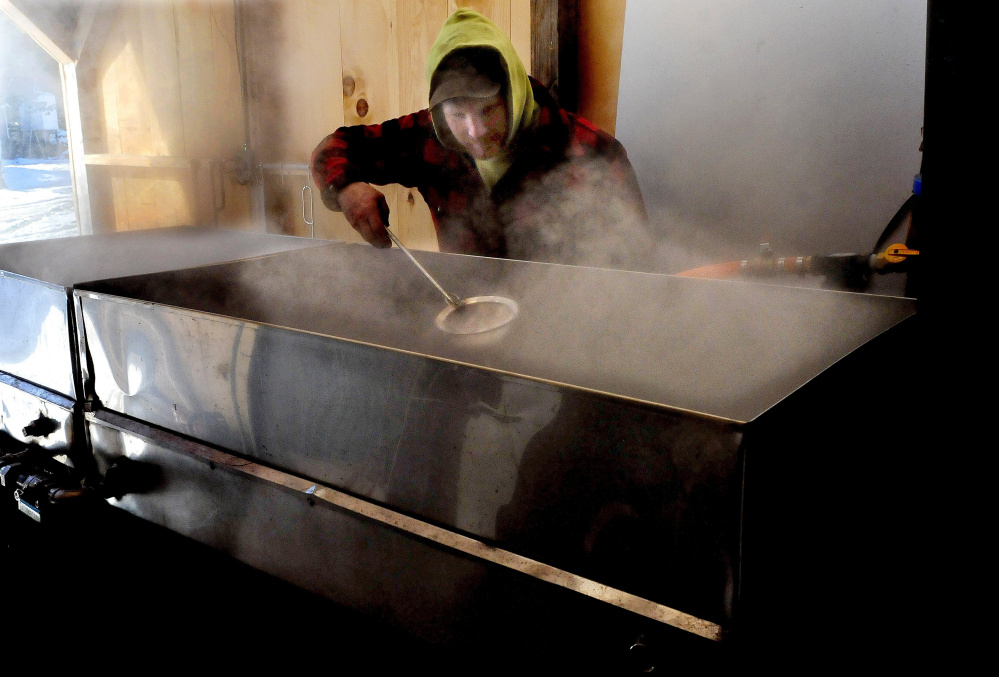 SKOWHEGAN,  ME0  March 3: Jason Tessier scoops off foam as maple sap boils down into maple syrup at his farm in Skowhegan on Thursday, March 3, 2016.  Tessier said this is the first time boiling this season and said it is still early and he expects conditions to improve soon. (Photo by David Leaming/Staff Photographer)