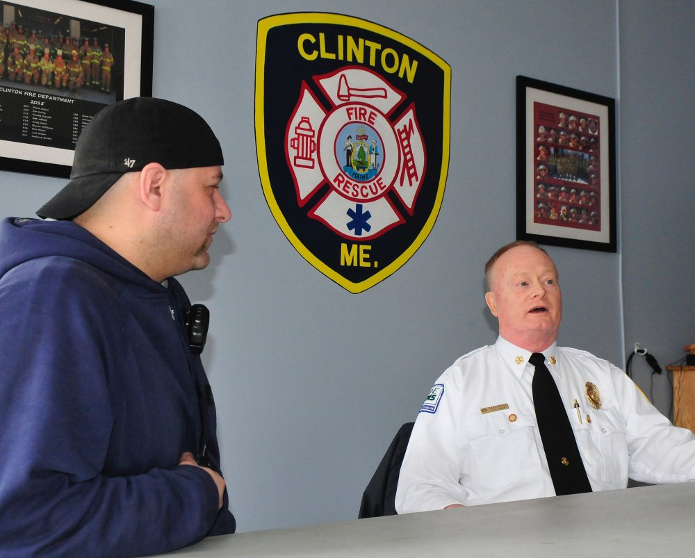 Retiring Clinton Fire Chief Gary Petley, right, speaks Wednesday about his long career as a firefighter, the last 25 years of which he was the fire chief. At left is firefighter Travis Fillmore.