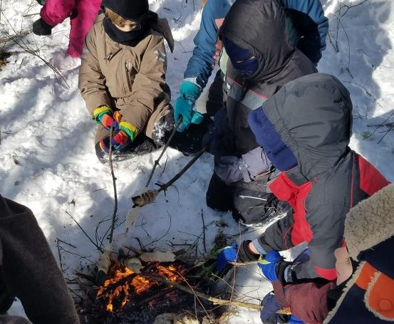 Local first- and second-graders from Juniper Hill School take part in the School in the Woods: Midcoast Conservancy, an outdoor classroom in Alna. A core part of the school's curriculum promotes student interaction with the natural world.