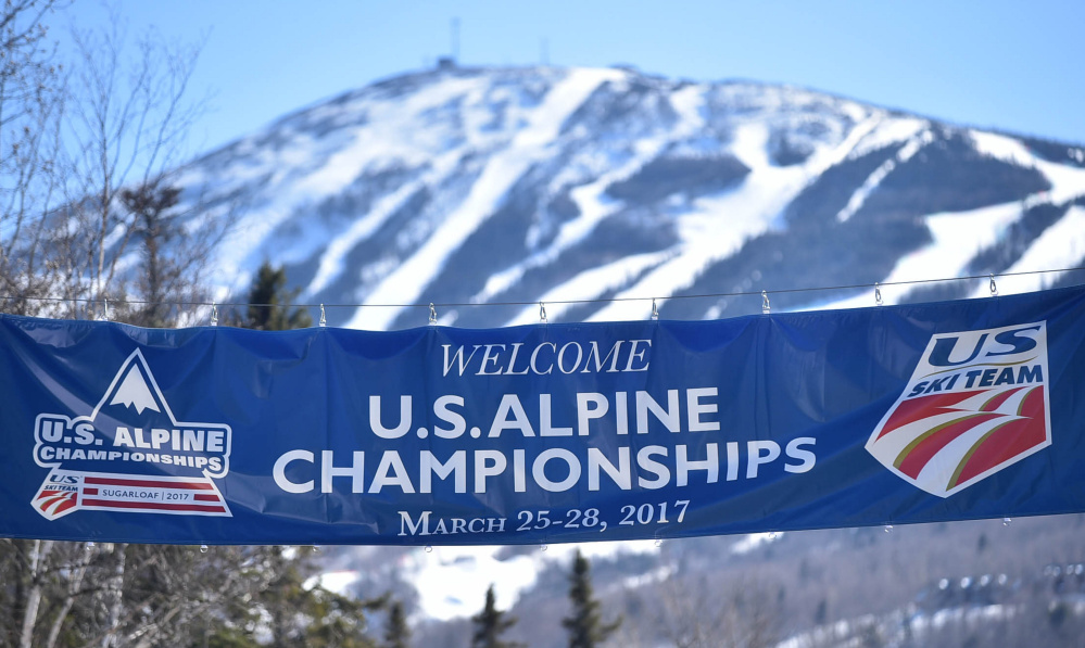 A sign welcoming competitors and visitors to the US Alpine Championships hangs over the entrance to Sugarloaf on Thursday in Carrabassett Valley.