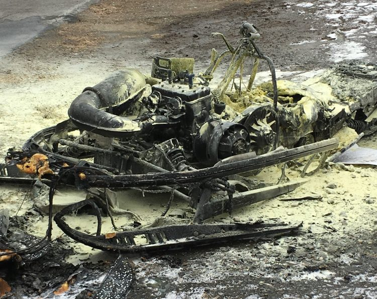 This snowmobile was destroyed Friday morning after bursting into flames in a garage off China Road in Winslow.