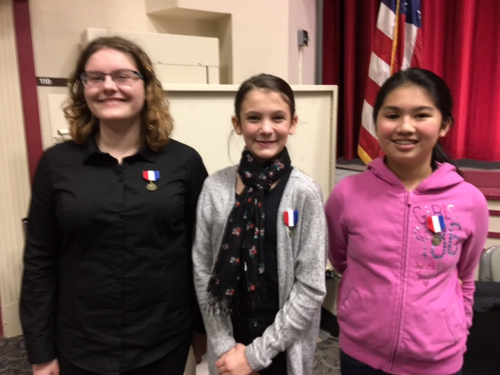 From left are Sydni Plummer of Windsor Elementary School, Ava Nadeau of St. Michael School, and Vealy Lai of Winthrop Middle School.