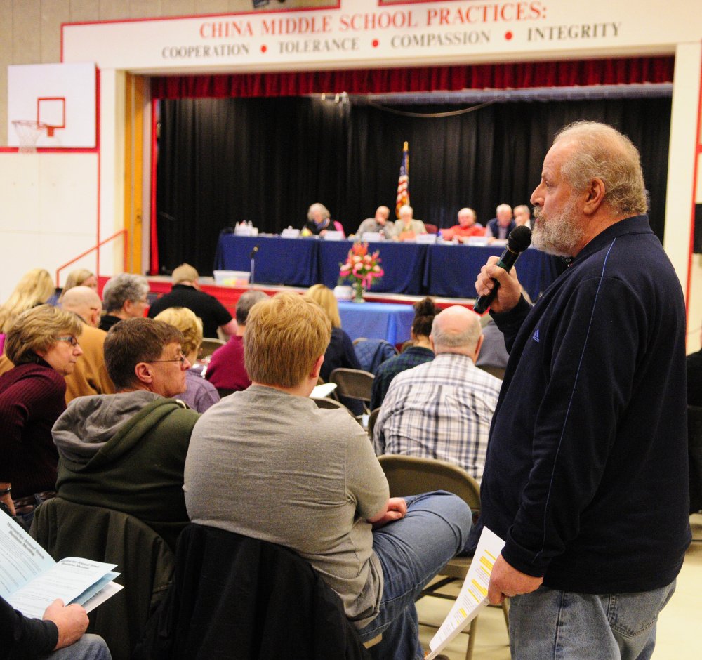 China Lake Association President Scott Pierz speaks during a debate Saturday at the China Town Meeting in the China Middle School gymnasium.