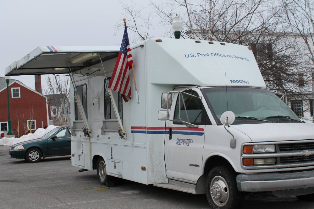 The United States Postal Service has begun offering retail services out of a van temporarily parked near the remains of Winthrop's post office, which was destroyed by a fire in February.