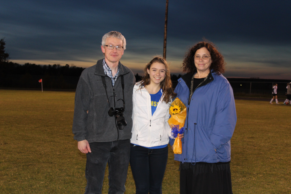 Allison Johnson, center, with her parents Tom, left, and Karen Johnson.