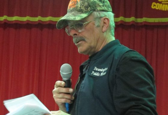 Jim Kiernan, Farmington's public works foreman, reads a statement to the assembled crowd at Monday night's Town Meeting.