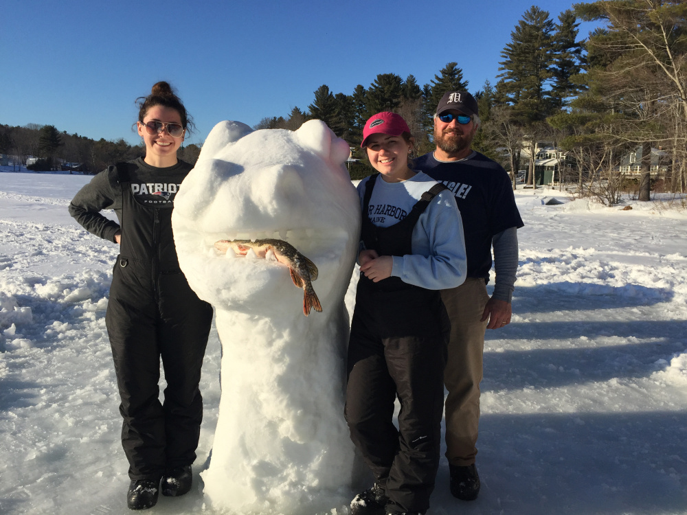 "From left are Molly, Emily and Jim Russell with ""The Cobbossee Lake Monster,"" which was 25 to 30 feet long."