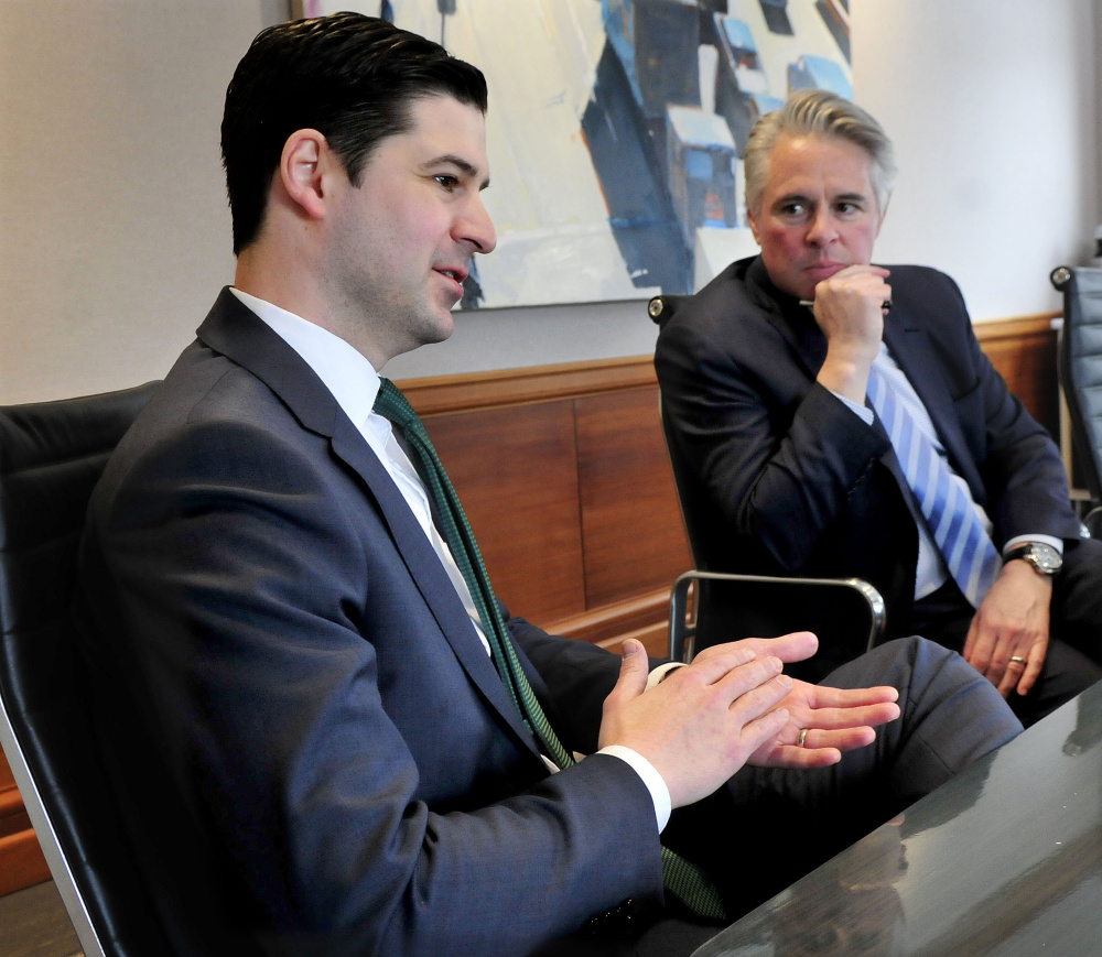 Waterville Mayor Nick Isgro, left, and Colby College President David Greene speak on Wednesday about revitalization plans and development of downtown Waterville.