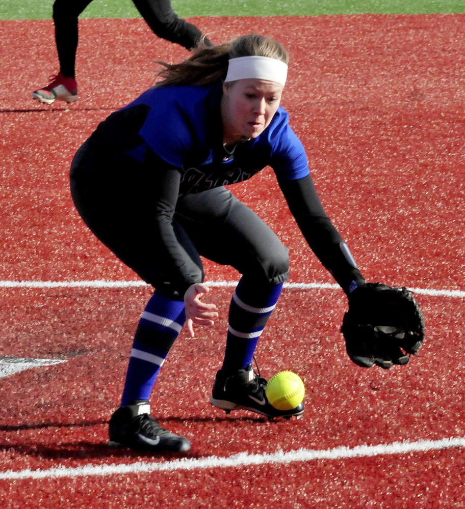 Colby pitcher Julia Saul fields a grounder against Thomas on Thursday in Waterville.