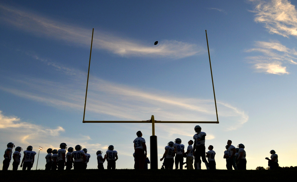 Players get ready before the start of the Lawrence-Mt. Blue football game last season.