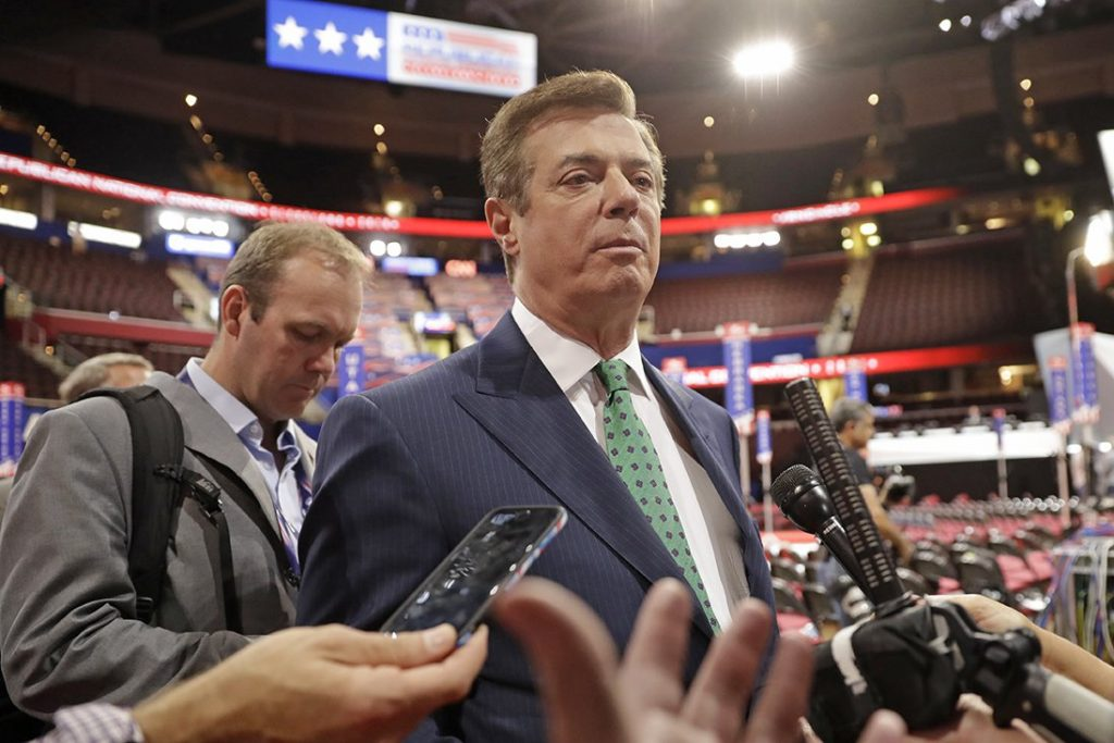 Trump campaign chairman Paul Manafort talks to reporters on the floor of the Republican National Convention in Cleveland on July 17, 2016.