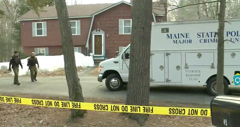 Police investigate a suspicious death at a home on Campground Road in Arundel on Wednesday.
