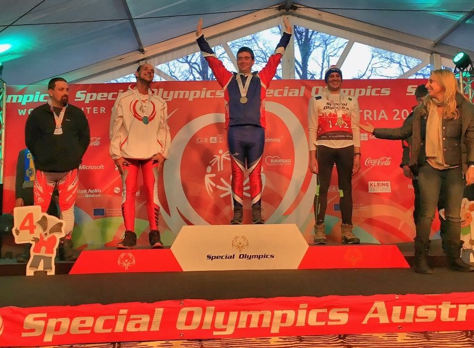 Lucas Houk is awarded the gold medal Monday for the men's 5-kilometer freestyle race.