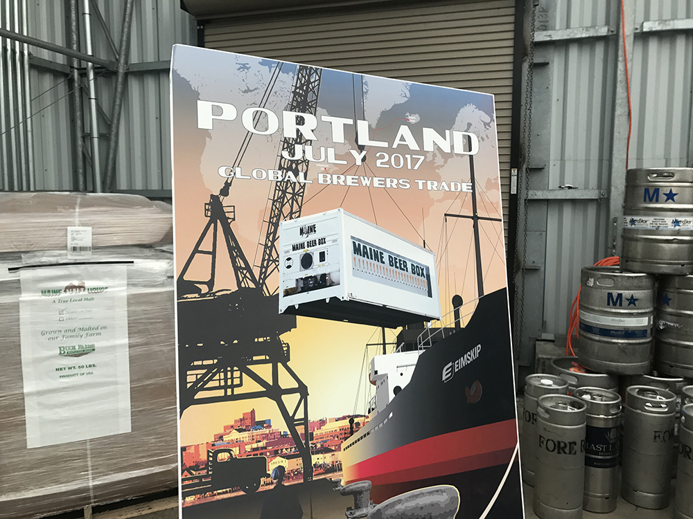 "A poster on display Thursday at  Eimskip's container facility on the Portland waterfront shows an artist's conception of the ""Maine Beer Box"" that will be shipped to Iceland for a June festival."