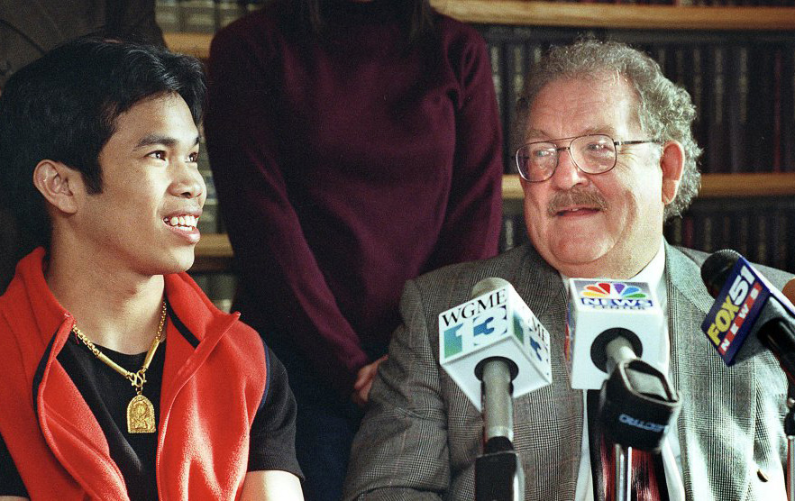 Dan Lilley shares Seiha Srey's elation at a March 2000 news conference after murder and other charges against Srey were dropped in a high-profile case involving a killing outside Denny's in Portland.