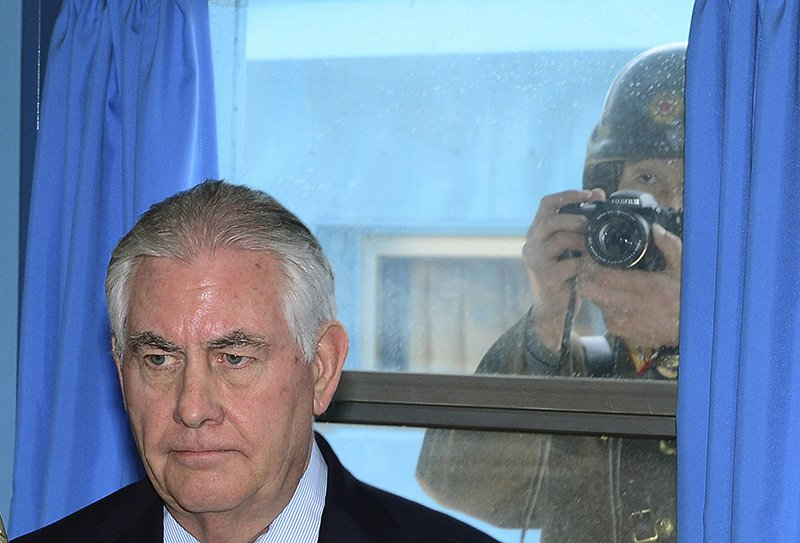 On Friday a North Korean soldier,  tries to take a photograph through a window while U.S. Secretary of State Rex Tillerson visits the U.N. Command Military Armistice Commission at the border village of Panmunjom in South Korea, which has separated the two Koreas since the Korean War.