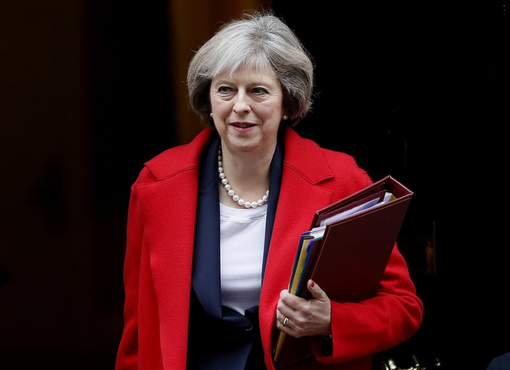 Britain's Prime Minister Theresa May says she will ask the House of Commons on Wednesday to back her election call.