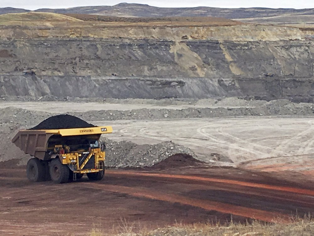 A dump truck the size of a house hauls coal at Contura Energy's Eagle Butte Mine near Gillette, Wyo., where President Trump's lifting of a federal coal-lease moratorium will allow new coal leasing to resume at the open pits in the Powder River Basin.