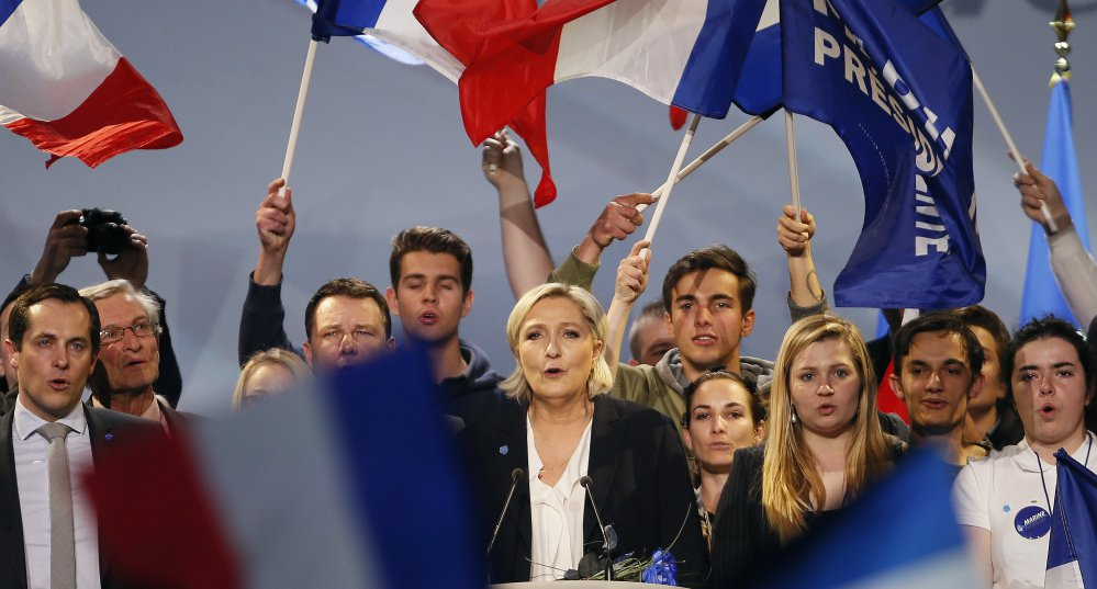 Marine Le Pen, a far-right presidential candidate in France, and her supporters sing after her speech Sunday in Bordeaux. Le Pen was the first foreign politician to congratulate Donald Trump after he was elected, but she now barely mentions his name in a country where nearly 8 in 10 voters strongly dislike the U.S. president.