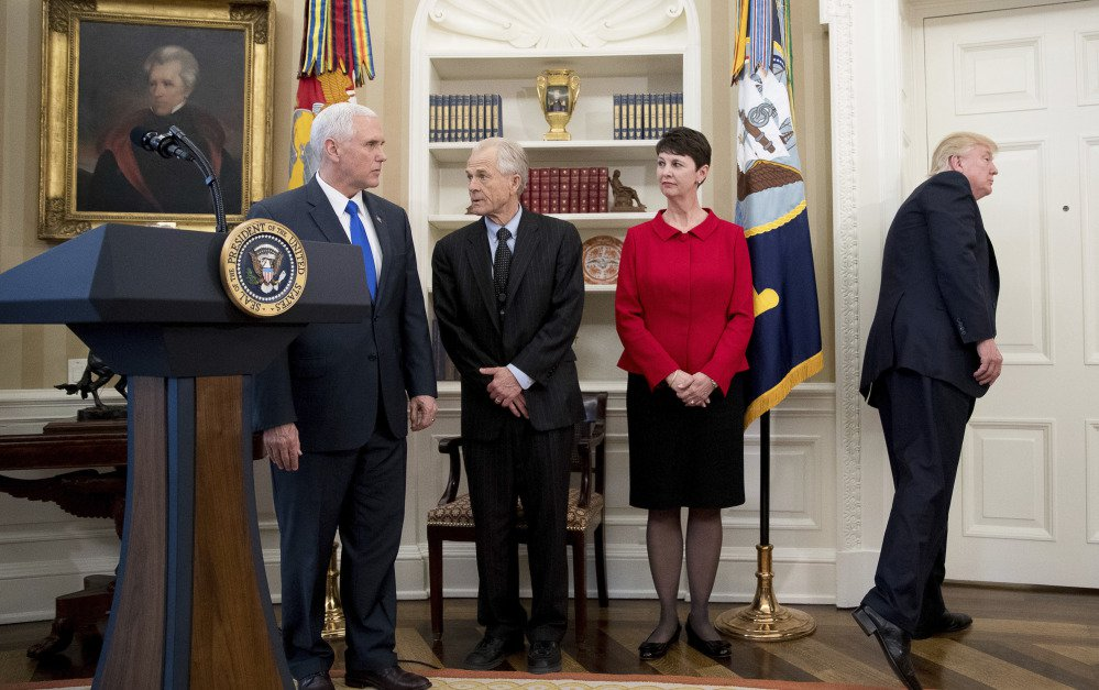 President Trump leaves after speaking but before signing executive orders regarding trade in the Oval Office at the White House on Friday. Also pictured, from left, are Vice President Mike Pence and National Trade Council adviser Peter Navarro.