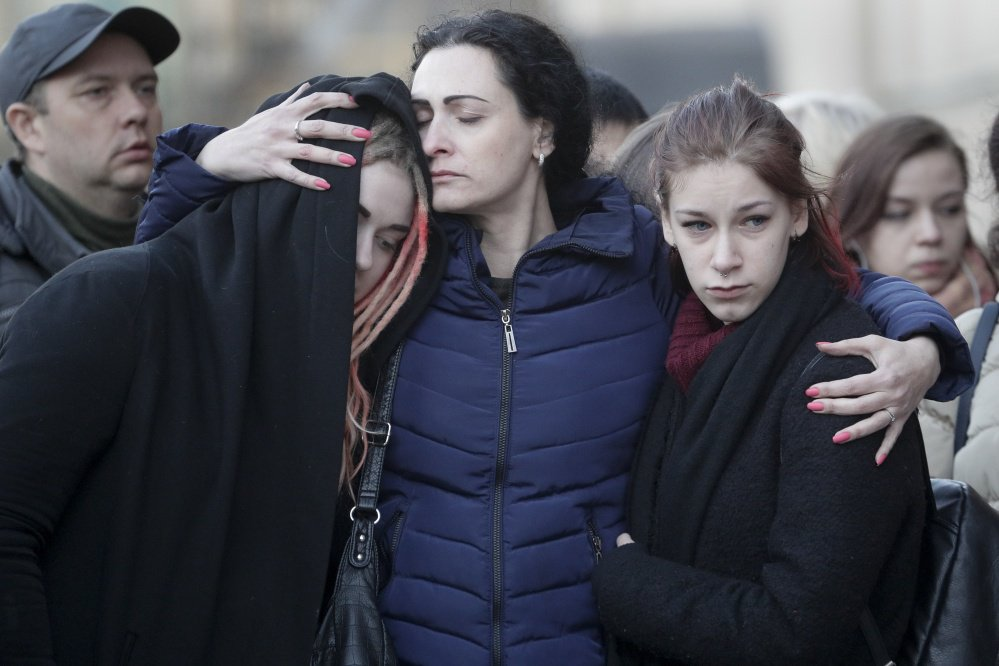 People mourn the victims of a suicide bomber in St. Petersburg, Russia, on Tuesday at a memorial at Technologicheskiy Institute subway station in St. Petersburg.