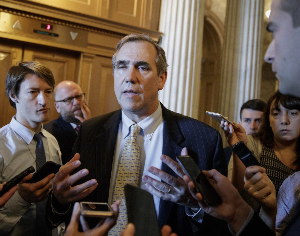 Sen. Jeff Merkley, D-Ore. speaks to reporters just outside the Senate chamber on Capitol Hill in Washington, Wednesday after ending a 15-hour, all-night talk-a-thon as the Senate heads toward a showdown over the confirmation vote for Supreme Court justice nominee Neil Gorsuch.