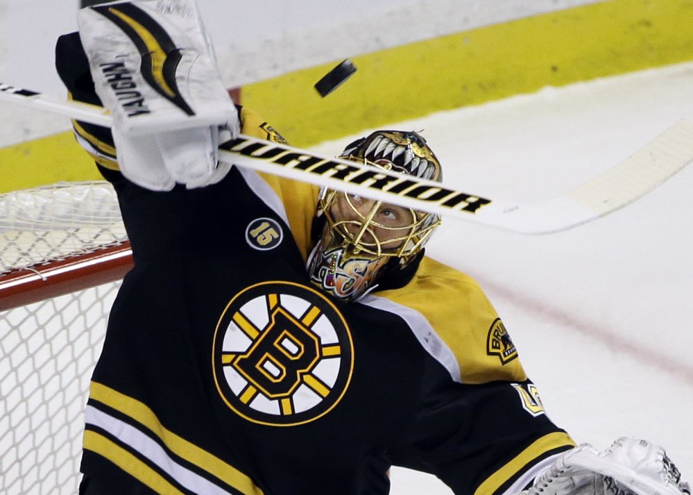 Bruins goalie Tuukka Rask makes a stick save during the first period Thursday night against the Ottawa Senators in Boston.