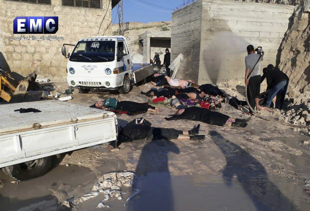 Crews retrieve victims of a suspected chemical attack in the town of Khan Sheikhoun, northern Idlib province, Syria, in this April 4 photo. A senior U.S. official says the United States has concluded that Russia knew in advance of the attack.