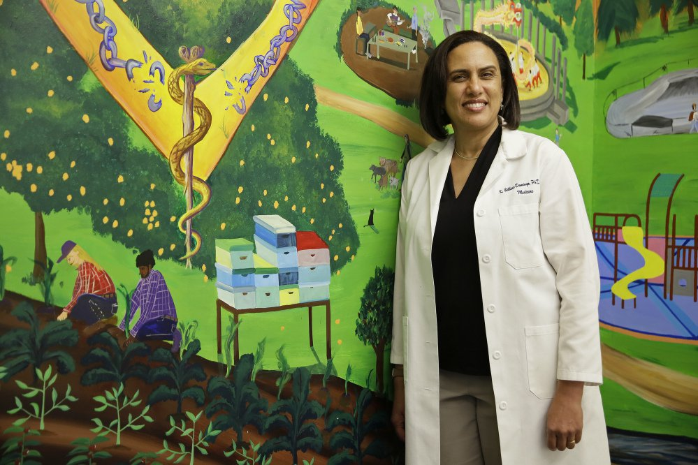 Dr. Kirsten Bibbins-Domingo, shown in the lobby of her office in San Francisco, always discusses the potential pros and cons of prostate cancer screening with her patients.