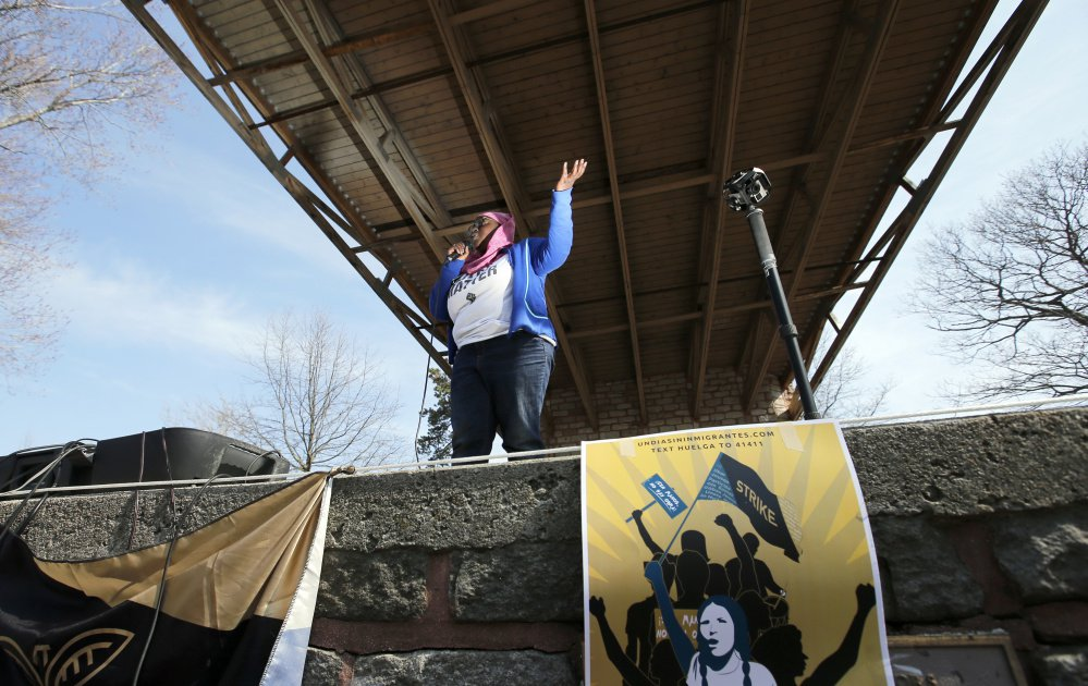 Organizer Samaa Abdurraqib speaks at Deering Oaks in Portland on Saturday during a rally in support of immigrants. An earlier rally at Portland City Hall drew a crowd of about 300 people.