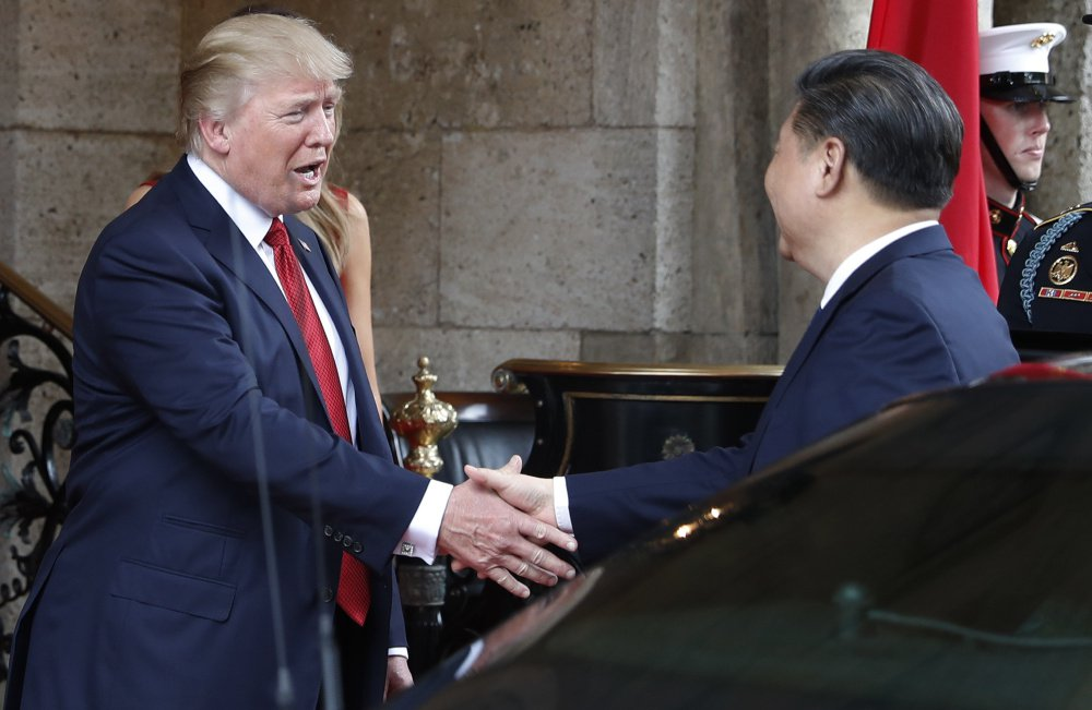 """President Trump greets Chinese President Xi Jinping at Mar-a-Lago resort, in Palm Beach, Fla., on April 6. On Thursday, he hailed the Chinese leader as """"a terrific person"""" and """"a very special man."""" Once soft on Russia and hard on China, Trump is changing his views on these world powers."""
