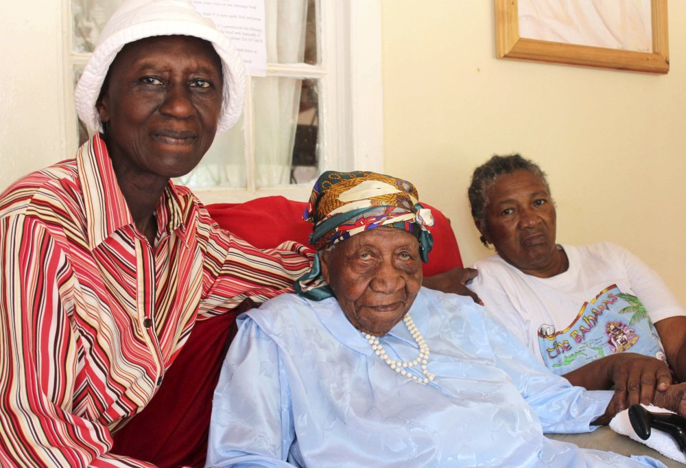 Violet Brown, center, poses with her caregivers in Jamaica on Sunday. Brown was a Jamaican who was the oldest verified living person in the world until her death at the age of 117 years, 189 days on September 15, 2017. She credits her longevity to hard work and faith. Associated Press/Raymond Simpson.