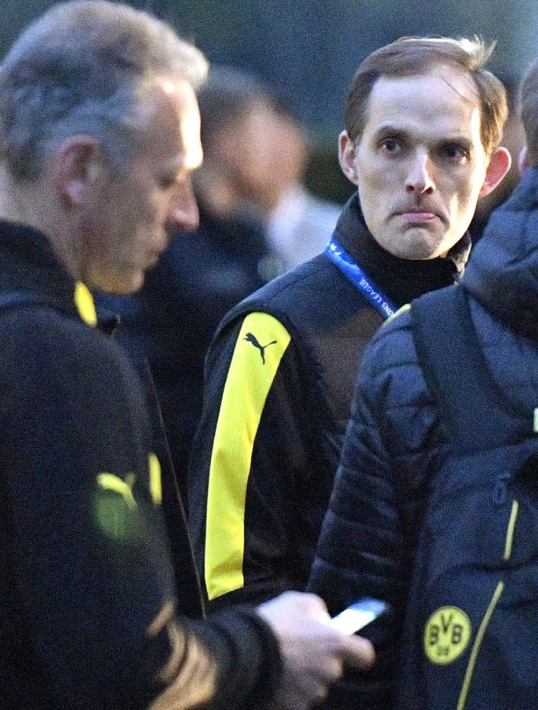Thomas Tuchel, Borussia Dortmund head coach, stands outside the team bus after an April 11 explosion.