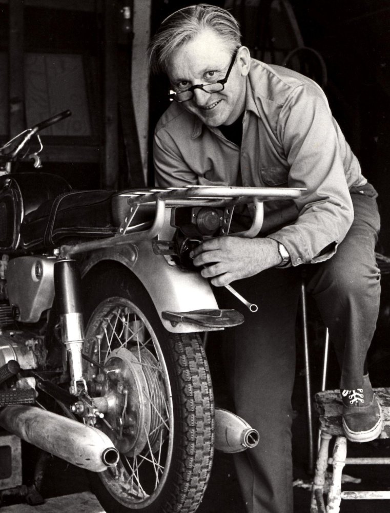 """Robert Pirsig works on a motorcycle in 1975. Pirsig, who wrote the classic """"Zen and the Art of Motorcycle Maintenance,"""" lived in South Berwick for 30 years."""