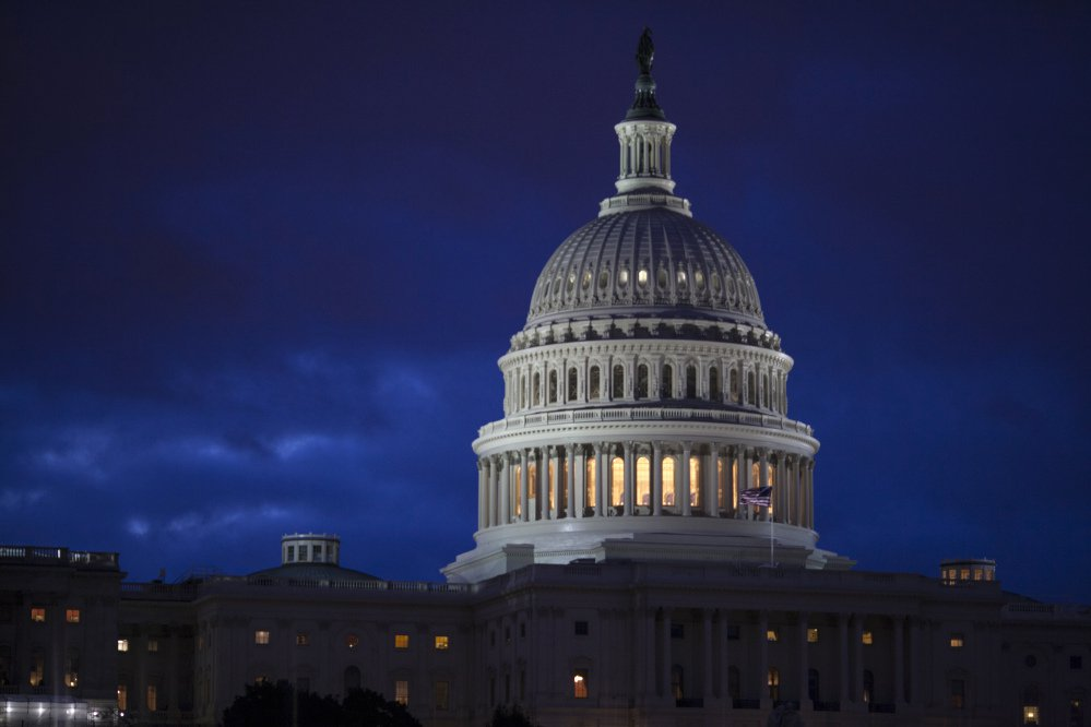 Bipartisan bargainers are making progress toward a budget deal to prevent a partial federal shutdown this weekend, a major hurdle overcome when President Trump signaled he would put off his demand that the measure include money to build his border wall with Mexico.