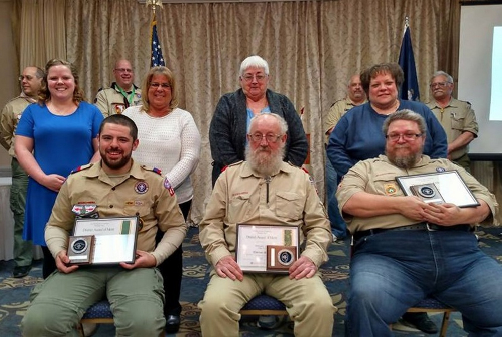 "Contributed photo Three local Scouting volunteers received the District Award of Merit at the Kennebec Valley District Annual Scout Leader Recognition Dinner held March 25 at the Waterville Lodge of Elks. They are Jared R. Bolduc, Clarence ""Buster"" Nutting and Raymond ""Jim"" VanAntwerp. Front, from left, are Jared Bolduc, Clarence Nutting and Raymond VanAntwerp; middle row, from left, are Blair Rueger, Kathy Bolduc, Gayle Nutting and Wendy VanAntwerp; and background row, from left, are District Chairman Rick Denico, Jay Pfingst, Pat Couture and Chuck Smith."