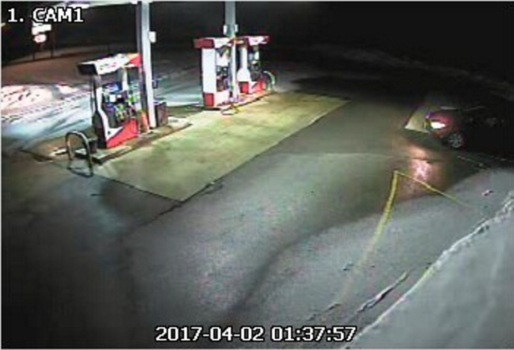 A surveillance photo from Annie's Market in Sidney shows a blue car that police think was driven by the man who damaged the convenience store early Sunday morning.