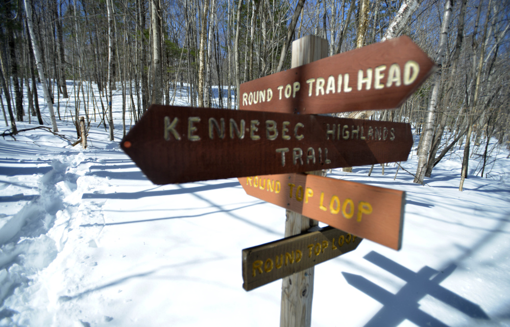 Trail signage marks the beginning of the Round Top Mountain trail in Rome on March 17, a day after game wardens found the body of Brian Peters on the mountain trail. Officials initially thought he had died of cold weather exposure, but the medical examiner says he died because of a sudden cardiac arrest.