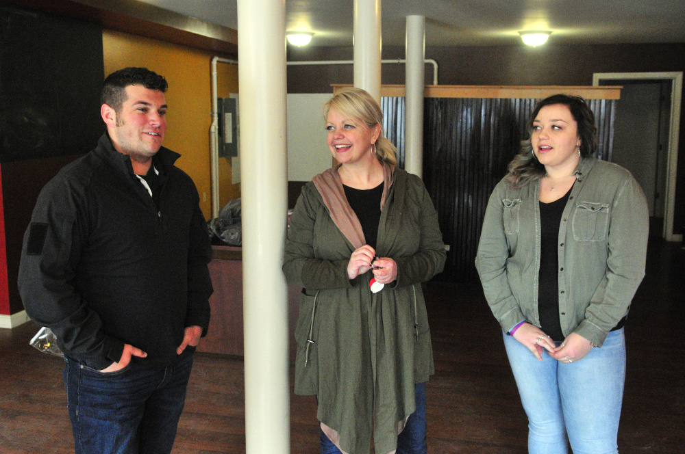 Tyler Arsenault, left, Kim Stoneton, and Haley Stoneton talks about plans for 8's Coffee Bar on March 24 in the first floor of a building Kim Stoneton owns at 130 Main St. in downtown Winthrop.