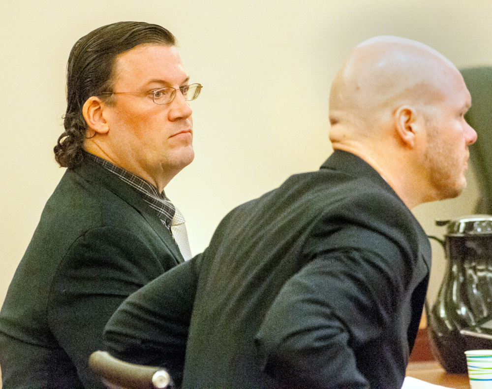 Michael Hein, left, and his attorney Scott Hess appear in court March 3 in the Capital Judicial Center in Augusta, where Hein was acquitted of a charge of animal cruelty.