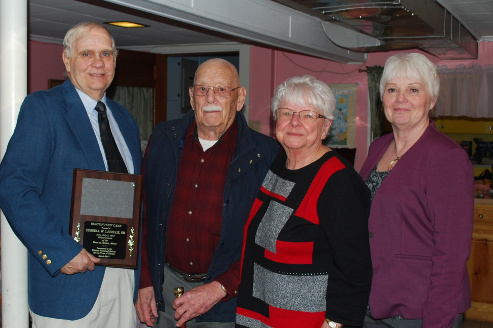Clinton Historical Society recently presented Russell Labelle, 97, of Clinton, with the town's Boston Post Cane. From left are Clinton Historical Society President Buddy Frost, Russell Labelle Sr. with his wife Hannah Labelle, and Clinton Town Manager Pam Violette.