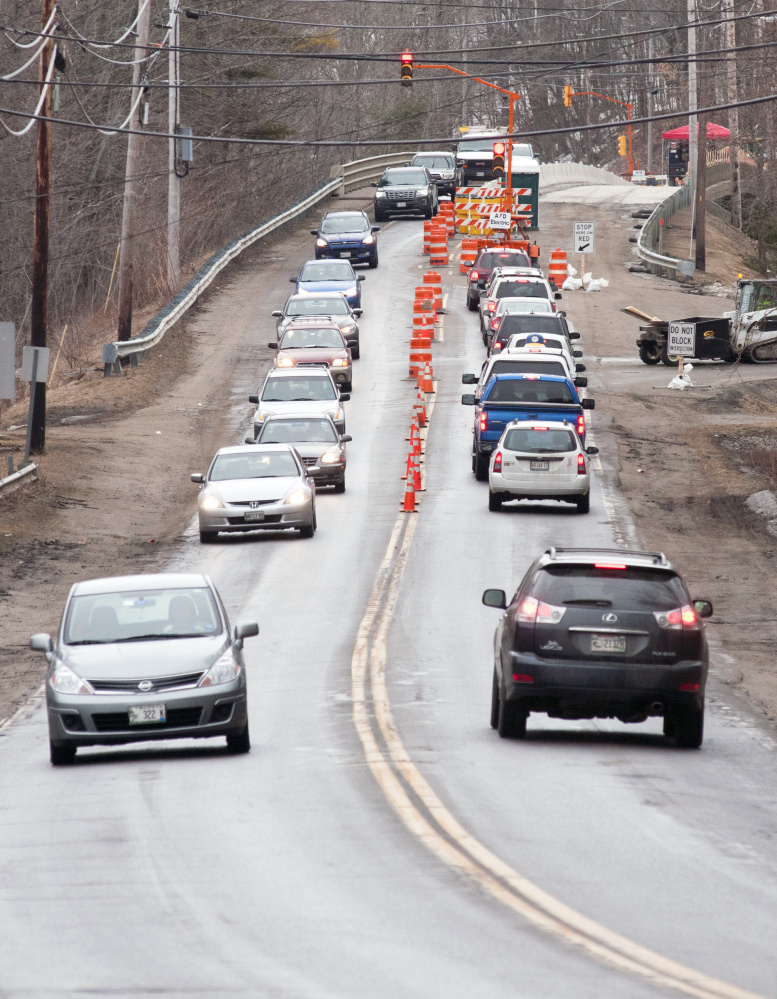 Traffic on Water Street backs up because of alternating traffic in just one lane Tuesday at Millikens Crossing Bridge in Hallowell.