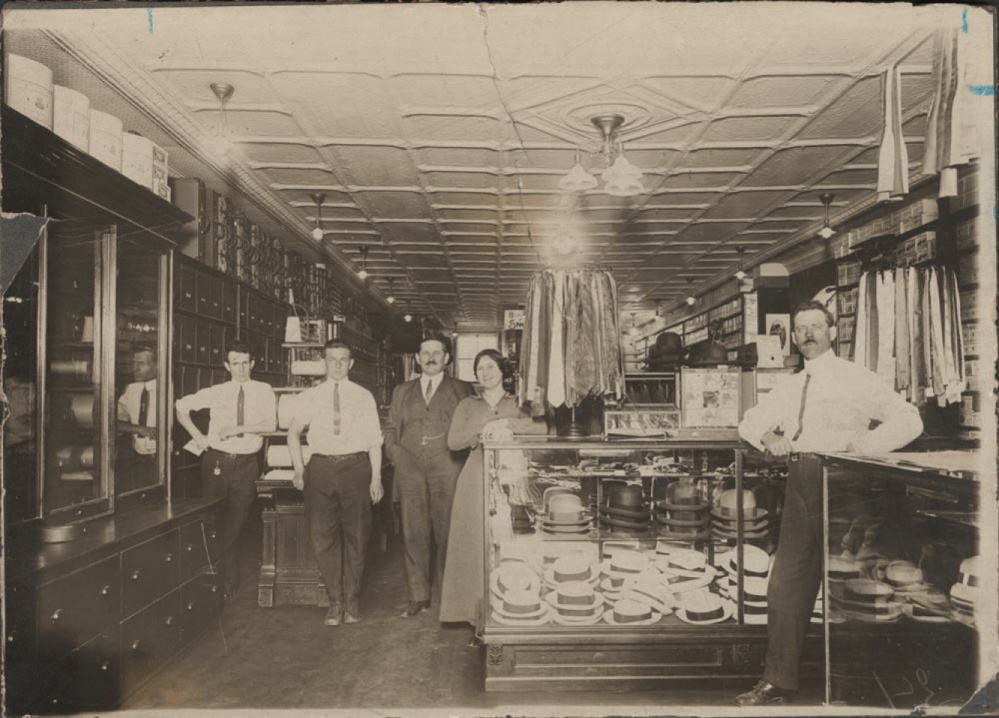 The interior of Levine's store with William Levine and store personnel, albumen print, 1908. The photo is part of the Levine Family Photograph Collection at Colby libraries.