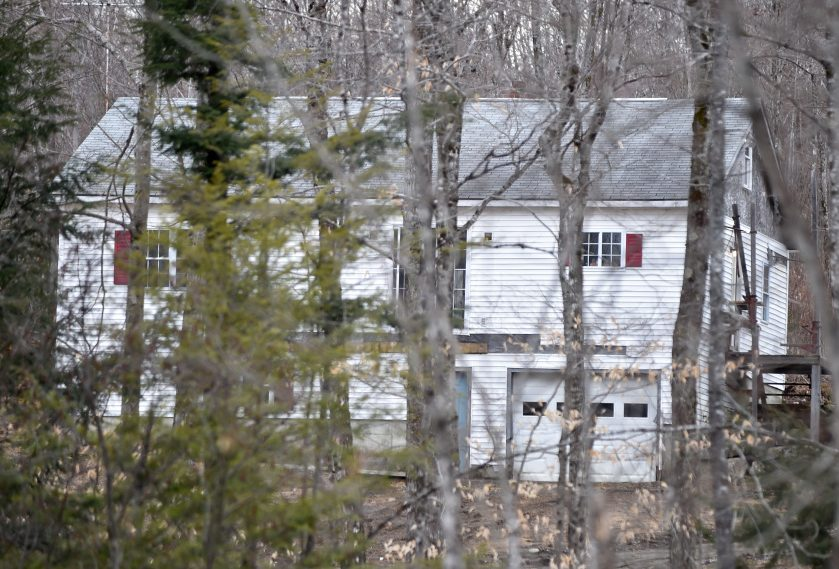 Maine State Police investigators block off McNally Road in St. Albans as they investigate the death of Randy Erving, 53, who was killed on April 8, 2016. Jeremy Erving, 24, a nephew of Randy Erving, is charged in connection with his uncle's death.